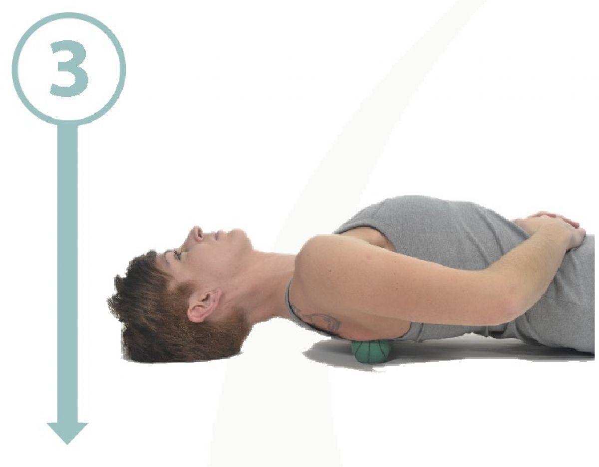 masaje de dorsales con una pelota